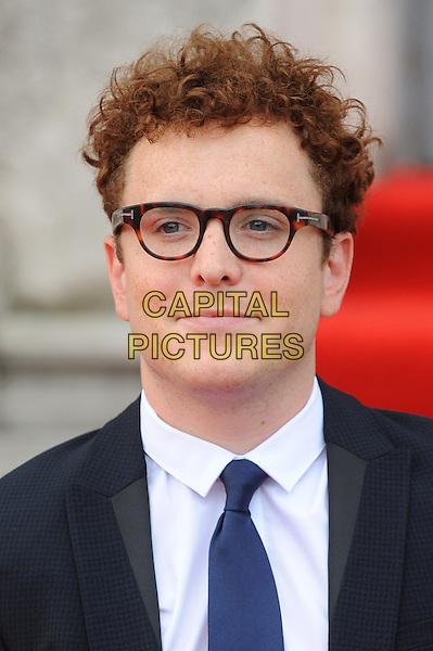 Joshua McGuire <br /> attends the World Premiere of About Time, Somerset House, London, UK, 8th August 2013.<br /> portrait headshot navy blue suit tie glasses <br /> CAP/BEL<br /> &copy;Tom Belcher/Capital Pictures