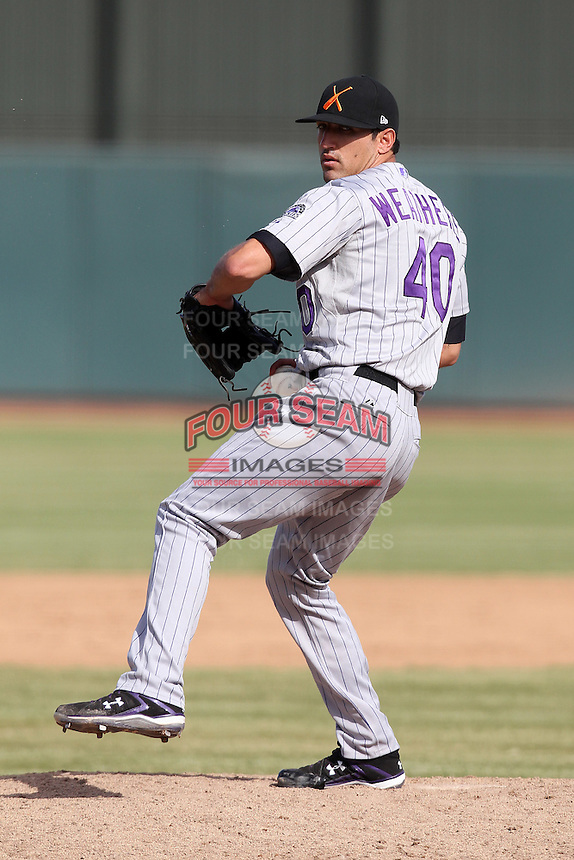 Salt River Rafters pitcher Casey Weathers #40 during an Arizona Fall League game against the Phoenix Desert Dogs at Phoenix Municipal Stadium on November 1, 2011 in Phoenix, Arizona.  Salt River defeated Phoenix 10-7.  (Mike Janes/Four Seam Images)