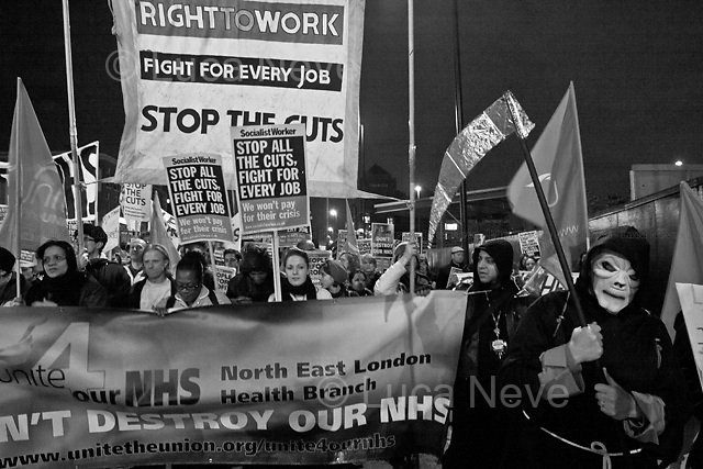 London, 09/03/2011. Around a thousand people marched from the Royal London Hospital (Whitechapel) to Bart's Hospital (near Barbican, City of London) protesting against the NHS cuts proposed by the Con/Dem Government. The march was attended by hospital workers, students (including medical students), trade union members, and citizens worried about the future of the National Health Service.