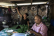Chef Tatung spends time with Antonia Betasolo in her house Relocation Golden Valley in the Barangay Pagkakaisa outside ofPuerto Princesa in the Philippines.<br /> Photograph: Sanjit Das/Panos for Greenpeace