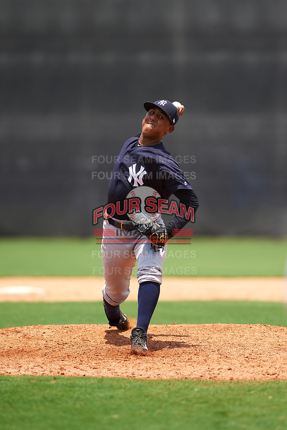 GCL Yankees East relief pitcher Edward Paredes (24) delivers a pitch during the second game of a doubleheader against the GCL Yankees West on July 19, 2017 at the Yankees Minor League Complex in Tampa, Florida.  GCL Yankees West defeated the GCL Yankees East 3-1.  (Mike Janes/Four Seam Images)