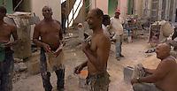construction workers taking a break and joking, street scene in Old Havana, Cuba