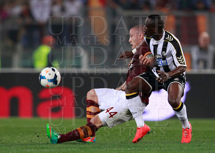 Calcio, Serie A: Roma vs Udinese. Roma, stadio Olimpico, 17 marzo 2014.<br /> AS Roma midfielder Radja Nainggolan, of Belgium, is challenged by Udinese midfielder Emmanuel Badu, of Ghana, during the Italian Serie A football match between AS Roma and Udinese at Rome's Olympic stadium, 17 March 2014.<br /> UPDATE IMAGES PRESS/Isabella Bonotto