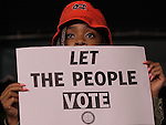 GREENSBORO, NC - NOVEMBER 3:   Keyanna Morrow (cq Keyanna), 19, holds a voter rights sign during a Moral March to the Polls event sponsored by the North Carolina NAACP in Greensboro, NC, on Monday, November 3, 2014.  (Photo by Ted Richardson/For The Washington Post)