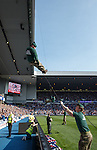 Royal Marines Commandos abseiling from the roof of the Govan Stand before kickoff