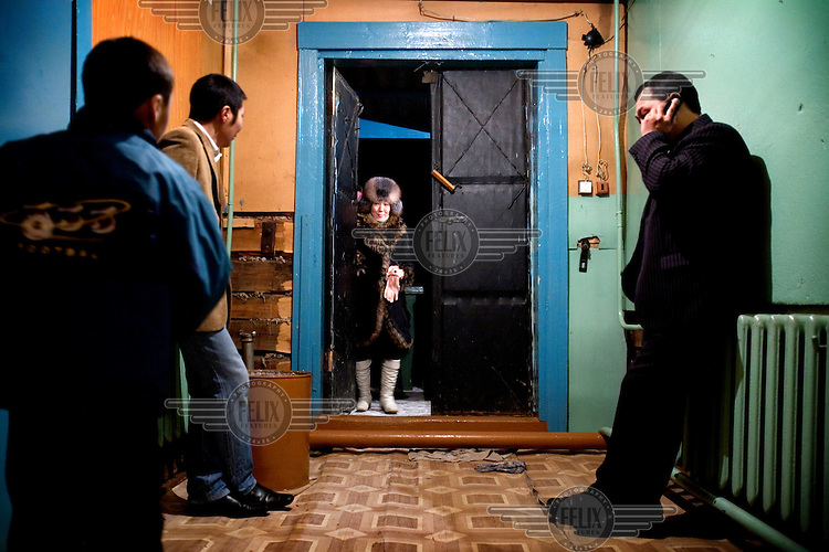 People wait outside of the hall where a school performance is taking place at the Bedime village in Yakutia..