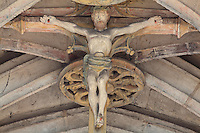 Sculpture of Christ on the cross in painted stone at the crown of the rib vaulted ceiling of the ambulatory in the Collegiate Church of Saint-Gervais-Saint-Protais, built 12th to 16th centuries in Gothic and Renaissance styles, in Gisors, Eure, Haute-Normandie, France. The church was consecrated in 1119 by Calixtus II but the nave was rebuilt from 1160 after a fire. The church was listed as a historic monument in 1840. Picture by Manuel Cohen