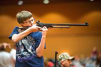 Walter Sanders (cq, age 13) with Tift County Sharpshooters practice shoot at the 2014 Daisy National BB Gun Championship Match in Rogers, Arkansas, Friday, July 4, 2014.<br /> <br /> Photo by Matt Nager