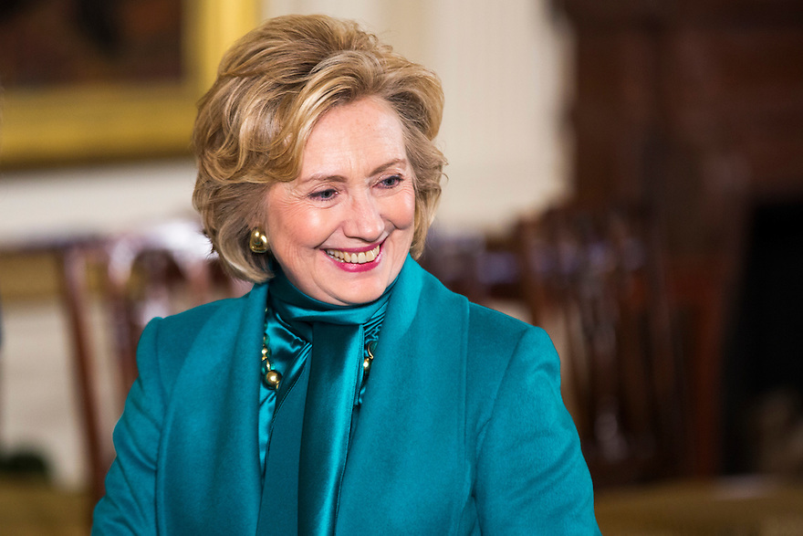 Former U.S. Secretary of State Hillary Clinton greets guests as they arrive at the Presidential Medal of Freedom presentation ceremony in the East Room at the White House in Washington.