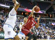 Washington, DC - March 10, 2018: Saint Joseph's Hawks guard Nick Robinson (5) tries to fake the defender during the Atlantic 10 semi final game between Saint Joseph's and Rhode Island at  Capital One Arena in Washington, DC.   (Photo by Elliott Brown/Media Images International)