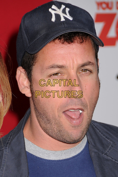 "ADAM SANDLER.""You Don't Mess With The Zohan"" LA Premiere at Grauman's Chinese Theatre, Hollywood, California, USA..May 28th, 2008.headshot portrait stubble facial hair blue jacket baseball cap mouth open funny face chewing gum .CAP/ADM/BP.©Byron Purvis/AdMedia/Capital Pictures."