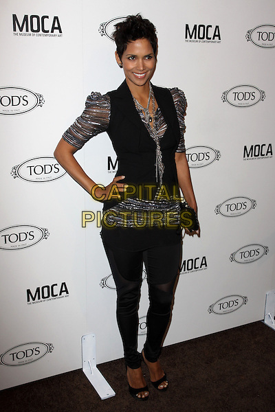 HALLE BERRY.Tod's Beverly Hills boutique Grand Opening held At Tod's Boutique, Beverly Hills, California, USA. .April 15th, 2010 .full length silver grey gray sheer puff leggings jeggings sleeve top waistcoat black vest clutch bag necklace sheer striped shiny hand on hip.CAP/ADM/KB.©Kevan Brooks/AdMedia/Capital Pictures.