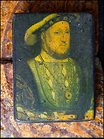 BNPS.co.uk (01202 558833)<br /> Pic: PhilYeomans/BNPS<br /> <br /> The Binney families minature painting of King Henry, after Holbein, on unearthed Tudor tiles on which he may have walked.<br /> <br /> Historic Wolf Hall, home to the Seymour family and star of Hilary Mantel's famous trilogy on Henry VIII th, has finally been definitively located after new discoveries around the much smaller ramshackle house that remains today. <br /> <br /> Despite it's fame, nobody really knew where the enormous Tudor pile actually was, or what it looked like, due to its very short but very influential existance in the middle of the tumultuous 16th century.<br /> <br /> Built with a million pound loan (&pound;2,400) from King Henry in 1531, brokered by Thomas Cromwell, the huge house was rapidly brick built in time for the King's pivotal visit with the court and troublesome wife Anne Boleyn in 1535, at which point Sir John Seymour's daughter Jane caught his eye, within a year Anne was dead and Jane, and the rest of the Seymour clan were in.<br /> <br /> They benefitted massively from Royal patronage and the dissolution of the monastries, but it all went wrong when Henry died and the brothers fell out and were later executed in a spectacular fall from power only 21 years after the house was built.<br /> <br /> Historian Graham Bathe and his team have now uncovered part of the outline of the original building, as well as the extensive Tudor brick sewer system that proves the huge scale of the 16th century mansion.