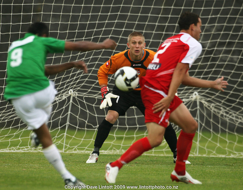 Waitakere keeper Danny Robinson braces for a shot from Seule Soromon..NZFC Championship soccer - Youngheart Manawatu v Waitakere United at Memorial Park, Palmerston North. Sunday, 15 November 2009. Photo: Dave Lintott/lintottphoto.co.nz