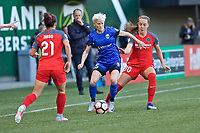 Portland, OR - Saturday May 06, 2017: Megan Rapinoe, Celeste Boureille during a regular season National Women's Soccer League (NWSL) match between the Portland Thorns FC and the Seattle Reign FC at Providence Park.