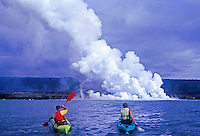 Ocean kayaking by the Kilauea volcanoe lava flow into the ocean, Hawaii