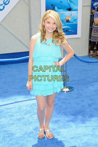 "STEFANIE SCOTT.Arrivals - Disneynature's Premiere Of ""Oceans"" held At El Caitan Theatre, Hollywood, California, USA..17th April 2010.full length blue layers layered dress hand on hip stephanie .CAP/ROT.©Lee Roth/Capital Pictures"