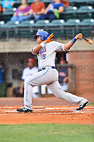 Kingsport Mets catcher Victor Moscote (15) swings at a pitch during a game against the Greeneville Astros at Pioneer Park on July 1, 2017 in Greeneville, Tennessee. The Astros defeated the Mets 6-2. (Tony Farlow/Four Seam Images)