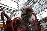 NEW YORK, USA - October 3: A Cosplayer gestures for a picture during day one of New York Comic Con on October 3, 2019 in New York, USA.<br /> The 2019 New York Comic-Con at the Jacob K. Javits Convention Center Day 1 with the latest in superhero movies, sci-fi shows, animation, video games, comic book releases available to attendees.<br /> (Photo by Luis Boza/VIEWpress/Corbis via Getty Images)