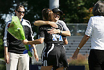 26 October 2008: Duke's Christie McDonald (14) is hugged by assistant coach Carla Overbeck during Senior Day festivities. The Duke University Blue Devils defeated the Clemson University Tigers 6-0 at Koskinen Stadium in Durham, North Carolina in an NCAA Division I Women's college soccer game.