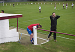 Gala Fairydean Rovers manager Steven Noble (in black) shows his frustration during his team's inaugural match in the Scottish Lowland Football League away to Whitehill Welfare at Ferguson Park. Gala were formed in 2013 by an a re-amalgamation of Gala Fairydean and Gala Rovers, the two clubs having separated in 1908 and Gala's Netherdale ground in Galashiels in the Scottish Borders had one of only two stands designated as listed football stands in Scotland. Whitehill won the match, the first-ever in the newly-formed Lowland League by 4 goals to 2.
