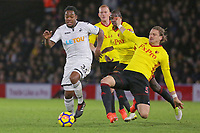 Sebastian Prodl of Watford (R) slide tackles Renato Sanches of Swansea City (L) during the Premier League match between Watford and Swansea City at the Vicarage Road, Watford, England, UK. Saturday 30 December 2017