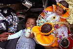 Mexico (02/02/2005): A little kid drinks milk as some Baby Jesus images rest next to him during an open mass in the Cathedral of Xochimilco, February 2, 2005. Tousands of people take their Baby Jesus to be blessed by priests. Mexico (02/02/2005) Un pequeno toma leche junto a vairas imagenes de Nino Jesus durante una misa al aire libre en la Catedral de Xochimilco. Miles de vecinos llevan sus imagenes para ser bendecidas por los sacerdotes...© Heriberto Rodriguez..NO ARCHIVO-NO ARCHIVE-ARCHIVIERUNG VERBOTEN! ..