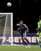New England Revolution defender Darrius Barnes (25) heads the ball. The New England Revolution defeated the Seattle Sounders FC, 3-1, at Gillette Stadium on September 4, 2010.