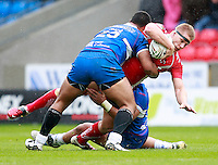 PICTURE BY CHRIS MANGNALL /SWPIX.COM...Rugby League - Super League  - Salford City Reds v Hull Kingston Rovers - Salford City Stadium , Eccles, England  - 09/04/12... Salford's Shannan McPherson tackled by  Hull's Mickey Paea and Constantine Mika
