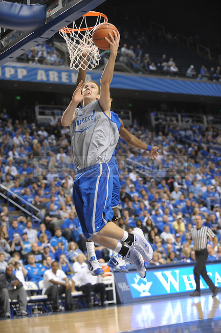 Sophomore Jon Hood lays it up during the UK mens basketball Blue/White scrimmage. Photo by Mike Weaver | Staff