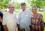 WOODBURY,  CT-072418JS22--Woodbury Lions Club past president Peter Perkinson, left, with Cam and Bonnie Gardella of Woodbury, at the Woodbury Lions Club Appreciation Picnic held at Hollow Park. The Lions Club wanted to thank people and volunteers who have supported their organization. More than 100 people were invited to the event. <br /> Jim Shannon Republican American