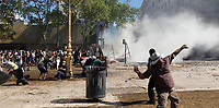 Rioters thorws stones during severe clashes   near the Congress building while Deputies Chamber was   discussing changes in   retirement legislation