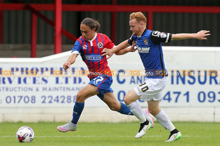 Connor Ogilvie of Stevenage and Jodi Jones of Dagenham during Dagenham and Redbridge vs Stevenage, Sky Bet League 2 Football at the London Borough of Barking and Dagenham Stadium, London, England on 29/08/2015