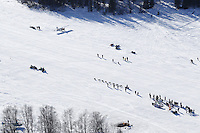 A team passes spectators on Long Lake in Willow, Alaska duirng the re-start of the 2011 Iditarod.