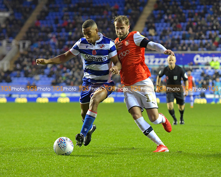 Andy Rinomhota of Reading left holds off Andrew Shinnie of Luton Town during Reading vs Luton Town, Sky Bet EFL Championship Football at the Madejski Stadium on 9th November 2019