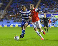 Andy Rinomhota of Reading left holds off AndrewShinnie of Luton Town during Reading vs Luton Town, Sky Bet EFL Championship Football at the Madejski Stadium on 9th November 2019