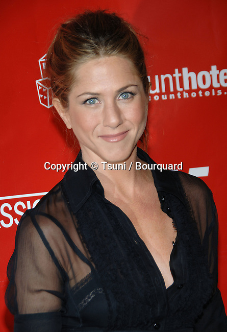 Jennifer Aniston  arriving at the Friends With Money Premiere at the Egyptian Theatre in Los Angeles, March 27, 2006.