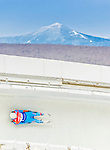 5 December 2014: Shiva Keshavan, sliding for India, slides through Curve Number 14 on his first run, ending the day with a 25th place finish and a combined 2-run time of 1:45.728 in the Men's Competition at the Viessmann Luge World Cup, at the Olympic Sports Track in Lake Placid, New York, USA. Mandatory Credit: Ed Wolfstein Photo *** RAW (NEF) Image File Available ***