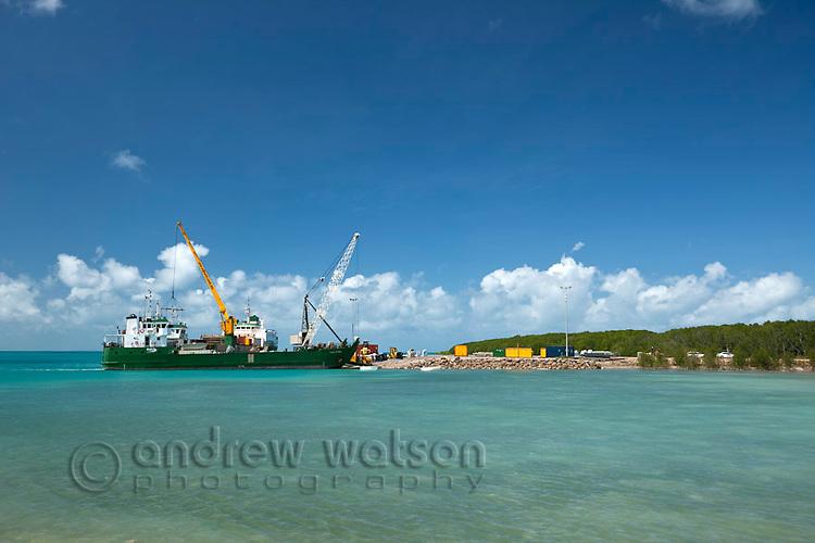 A cargo ship unloads carge at the port.  Horn Island, Torres Strait Islands, Queensland, Australia