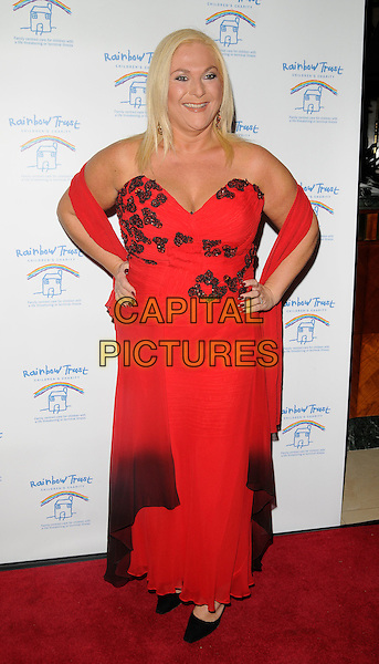 VANESSA FELTZ .Inside Arrivals - The Spirit of Cuba Ball, .London Hilton Park Lane Hotel, London, England, November 15th 2008..full length red dress strapless wrap shawl dip dye ombre black butterflies hands on hips .CAP/CAN.©Can Nguyen/Capital Pictures