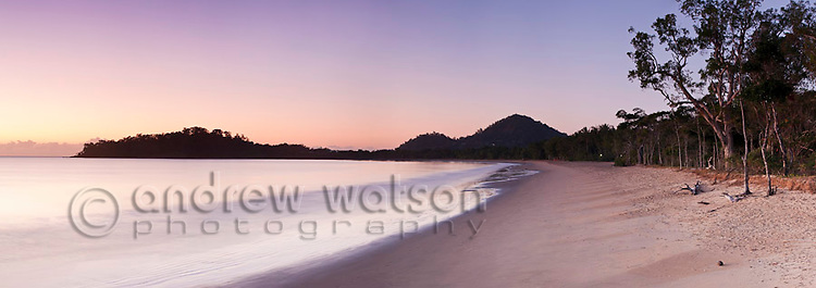 View along beach at dawn.  Kewarra Beach, Cairns, Queensland, Australia .