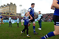 Paul Grant of Bath Rugby mascot in hand runs out onto the field. Gallagher Premiership match, between Bath Rugby and Harlequins on March 2, 2019 at the Recreation Ground in Bath, England. Photo by: Patrick Khachfe / Onside Images