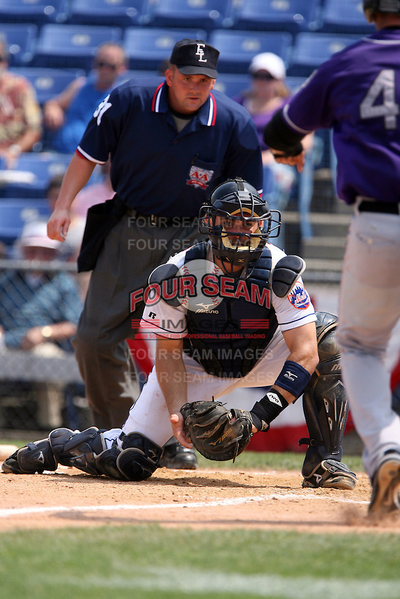 July 7th 2008:  Catcher Mike Nickeas of the Binghamton Mets, Class-AA affiliate of the New York Mets, blocks the plate as umpire Brad Purdom looks on during a game at NYSEG Stadium in Binghamton, New York.  (Mike Janes/Four Seam Images)