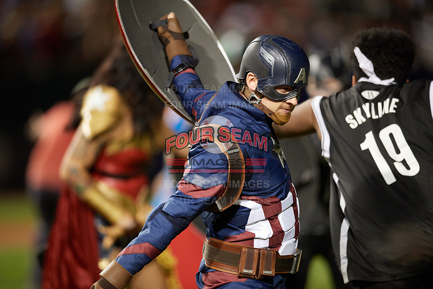 An actor portraying Captain America during an on field performance after a Buffalo Bisons game against the Gwinnett Braves on August 19, 2017 at Coca-Cola Field in Buffalo, New York.  The Bisons wore special Superhero jerseys for Superhero Night.  Gwinnett defeated Buffalo 1-0.  (Mike Janes/Four Seam Images)