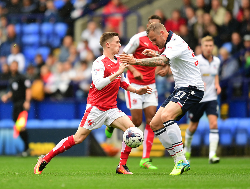 Fleetwood Town's Ashley Hunter is tackled by Bolton Wanderers's David Wheater<br /> <br /> Photographer Chris Vaughan/CameraSport<br /> <br /> Football - The EFL Sky Bet League One - Bolton Wanderers v Fleetwood Town - Saturday 20 August 2016 - Macron Stadium - Bolton<br /> <br /> World Copyright &copy; 2016 CameraSport. All rights reserved. 43 Linden Ave. Countesthorpe. Leicester. England. LE8 5PG - Tel: +44 (0) 116 277 4147 - admin@camerasport.com - www.camerasport.com