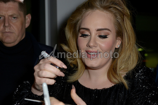 """06 December 2015 - Cologne, Germany - British singer Adele at Airport Cologne/Bonn after her performance for the RTL television broadcast of """"2015! People, Pictures, Emotions"""". Photo Credit: Philipp Mertens/face to face/AdMedia"""