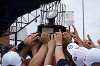 The Virginia Cavaliers baseball team holds the 2009 ACC Baseball Championship trophy after defeating the Florida State Seminoles 6-3 at Durham Bulls Athletic Park May 24, 2009 in Durham, North Carolina.  (Photo by Brian Westerholt / Four Seam Images)