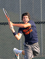 STAFF PHOTO FLIP PUTTHOFF <br /> Derek Groomer practices on Friday Aug. 8 2014 with the War Eagles tennis team.