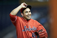 Louisville Bats infielder Alberti Chavez (29) is all smiles as he walks off the field after being pressed into service as a relief pitcher during the game against the Durham Bulls at Durham Bulls Athletic Park on May 28, 2019 in Durham, North Carolina. The Bulls defeated the Bats 18-3. (Brian Westerholt/Four Seam Images)