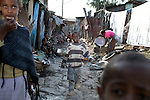 ADDIS ABABA, ETHIOPIA - NOVEMBER 5: Children play in a poor area on November 5, 2010 in central Addis Ababa, Ethiopia. (Photo by: Per-Anders Pettersson